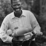 Black American Lonnie Johnson NASA engineer and inventor of the Super Soaker holding his invention